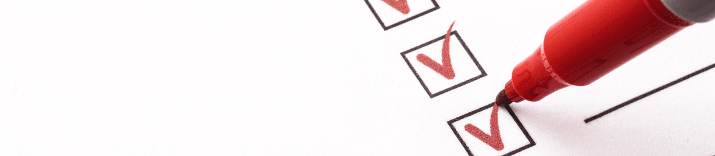 A red pen ticking boxes