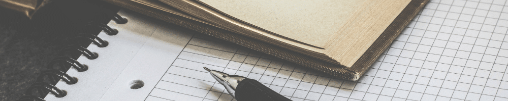 A pen and book on graph paper