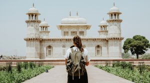 A woman in a backpack in front of Tomb of I'timād-ud-Daulah, Agra, India