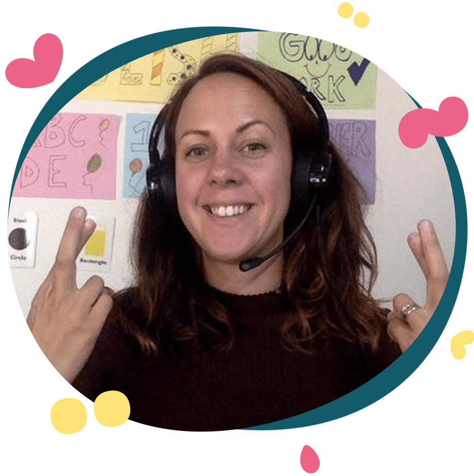 Female online English teacher smiling and wearing a headset