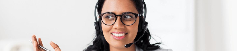 A woman wearing a headset teaching online