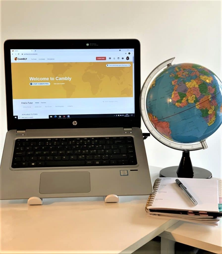 A laptop with the homepage for the online teaching site, Cambly, on screen